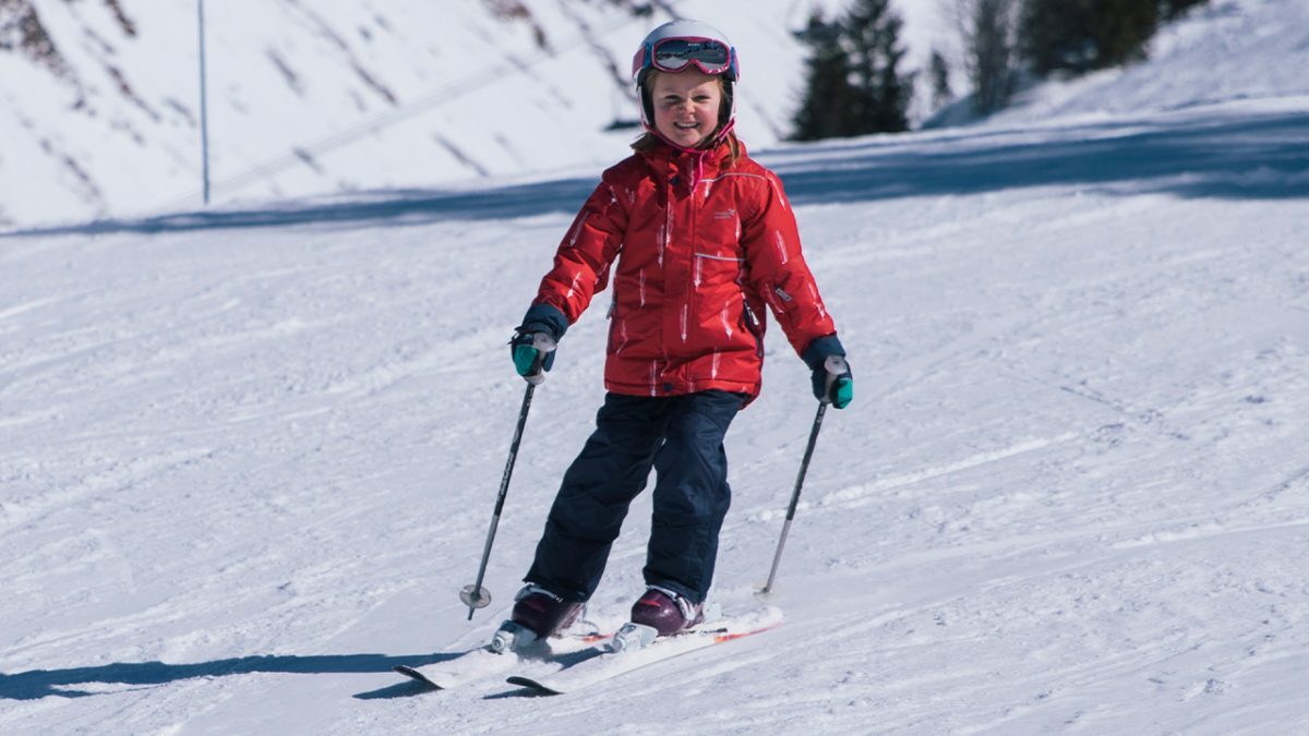 girl skiing- muddy puddles blizzard jacket