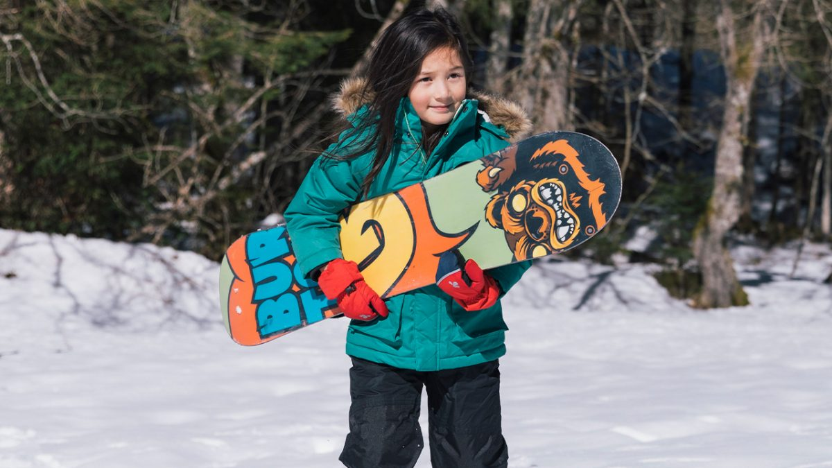 girl ready to snowboard