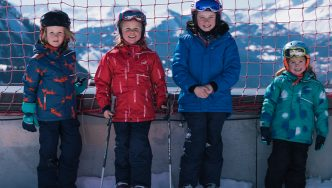 group-children-muddy puddles ski jackets