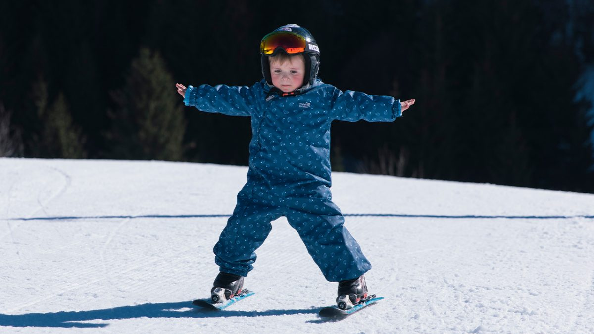 boy learning to ski- scampsuit
