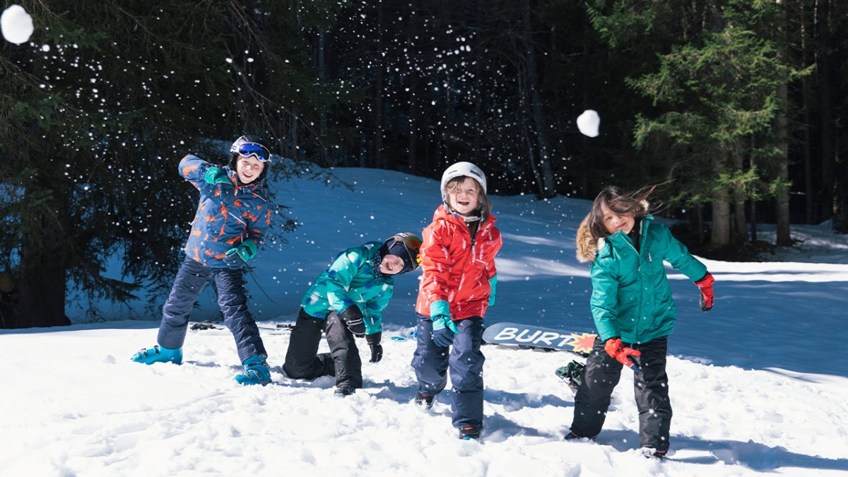 children throwing snow balls-