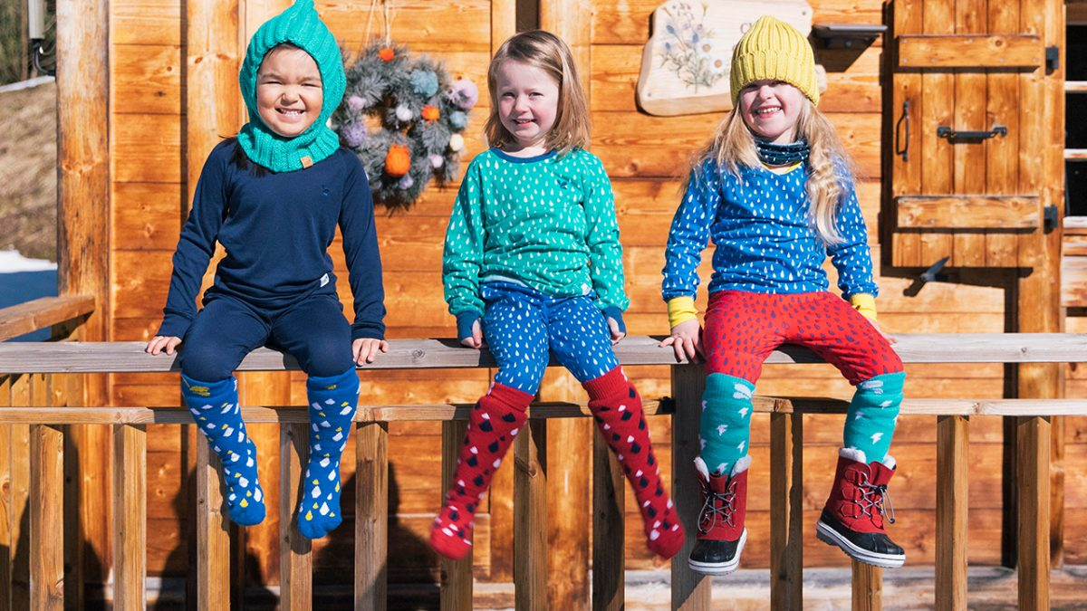 girls wearing base layer thermals, balaclava and snowboots - chalet