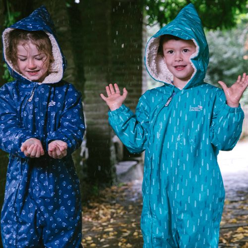boy and girl wearing Muddy Puddles Scampsuit