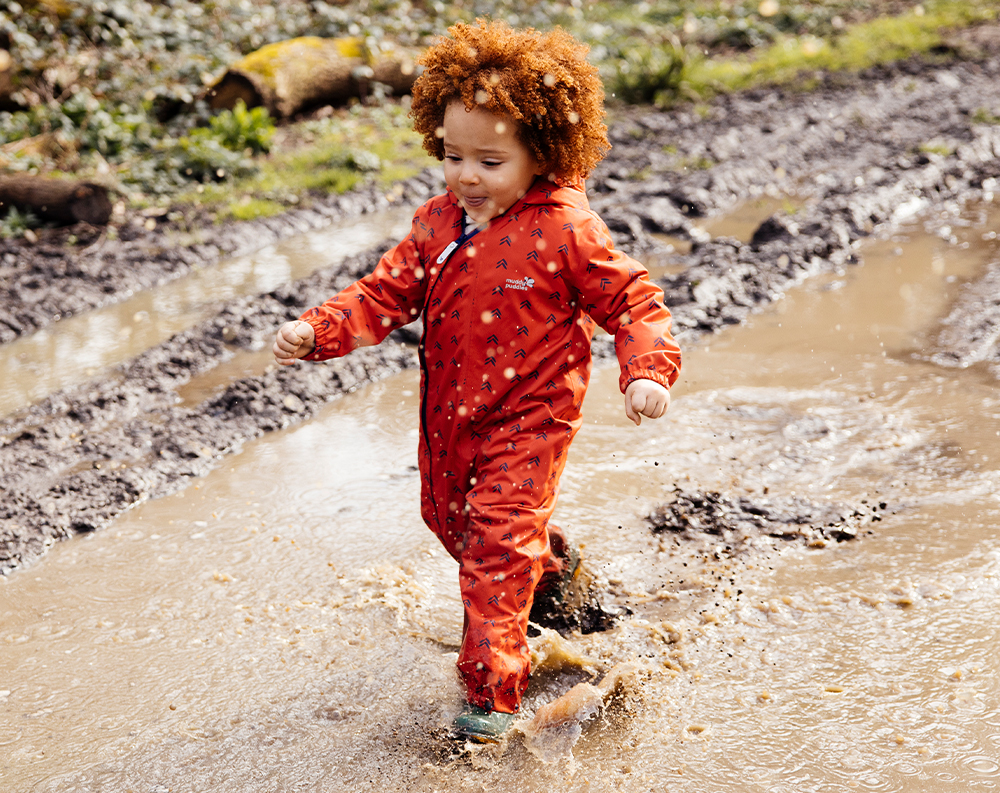 boy wearing bright red scampsuit