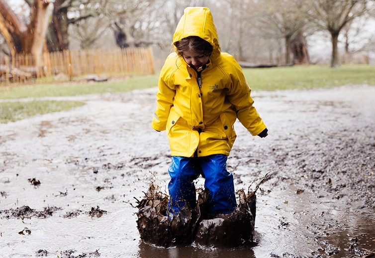 girl puddle jumping