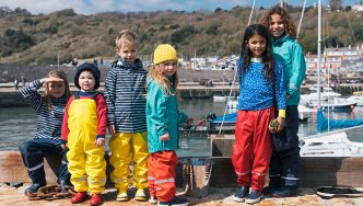 group of children wearing waterproof clothing