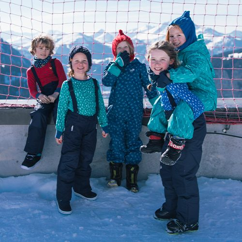 group of children in salopette and snow suits