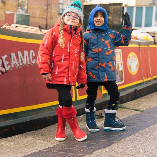 boy and girl blizzard jacket by the canal