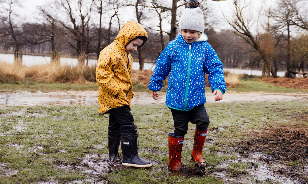 boys playing in mud